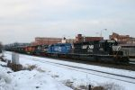 An Eastbound loaded coal drag passes the Altoona Amtrak station